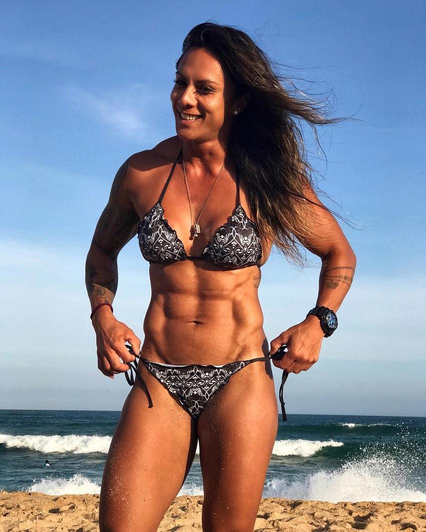 Carolinne Hobo standing on the beach in her bikini