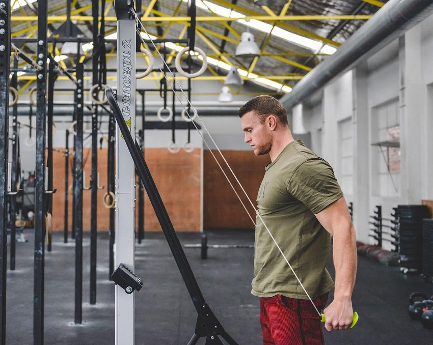 Chad Mackay doing triceps cable extensions looking lean and strong