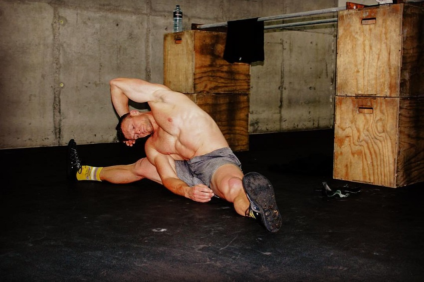 Chad Mackay stretching after his intense training in CrossFit