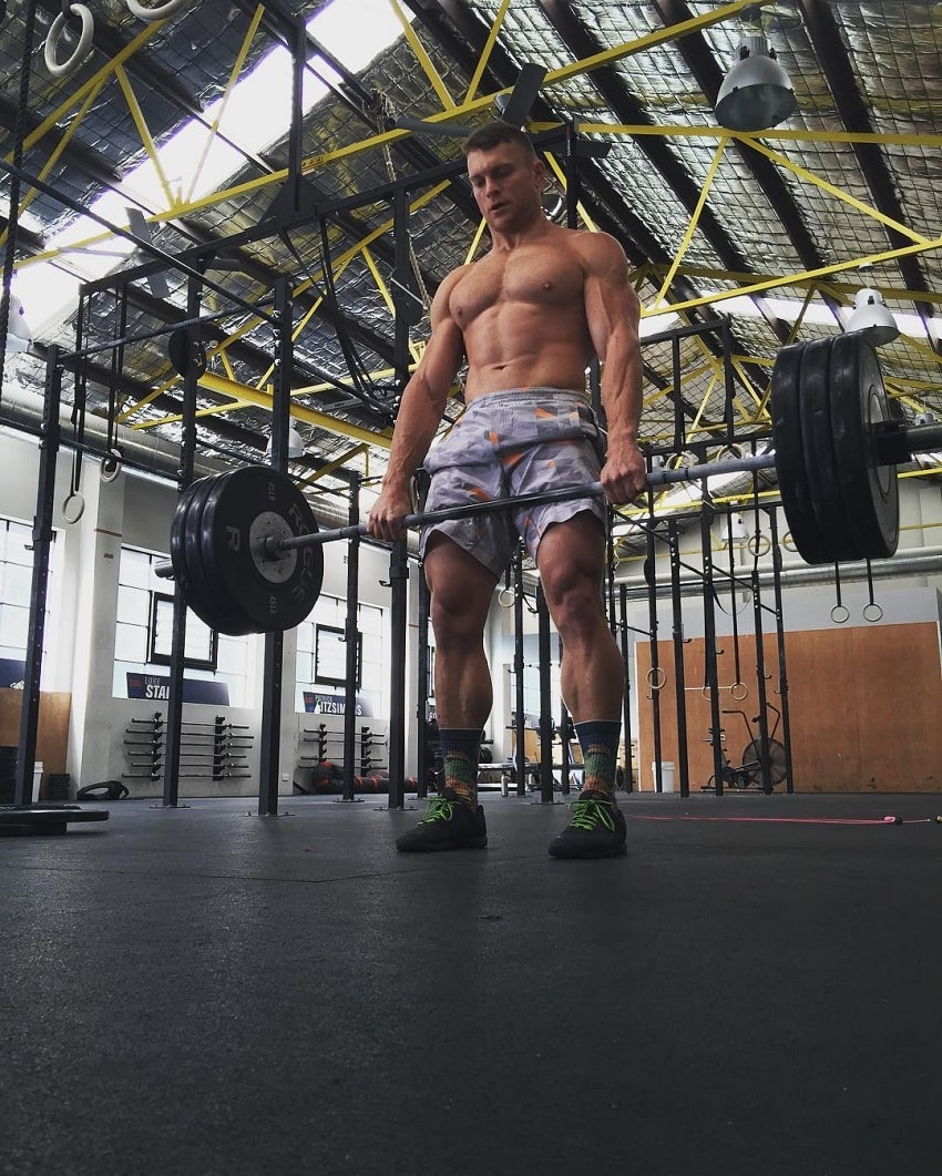 Chad Mackay doing heavy deadlifts in a CrossFit gymnasium