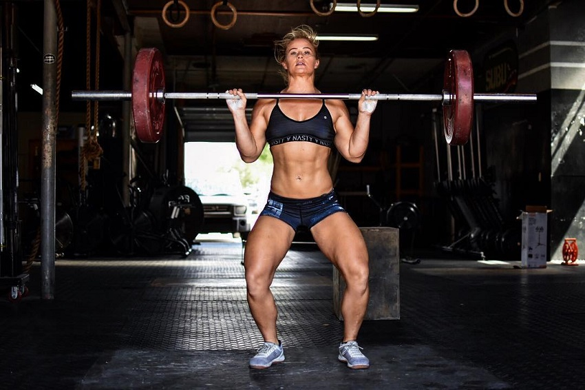 Dani Elle Speegle doing an overhead barbell press in CrossFit training