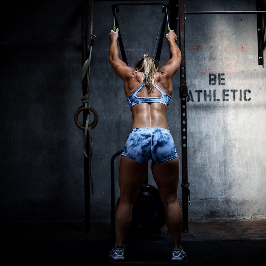 Dani Elle Speegle performing an exercise during a photo shoot looking fit and lean