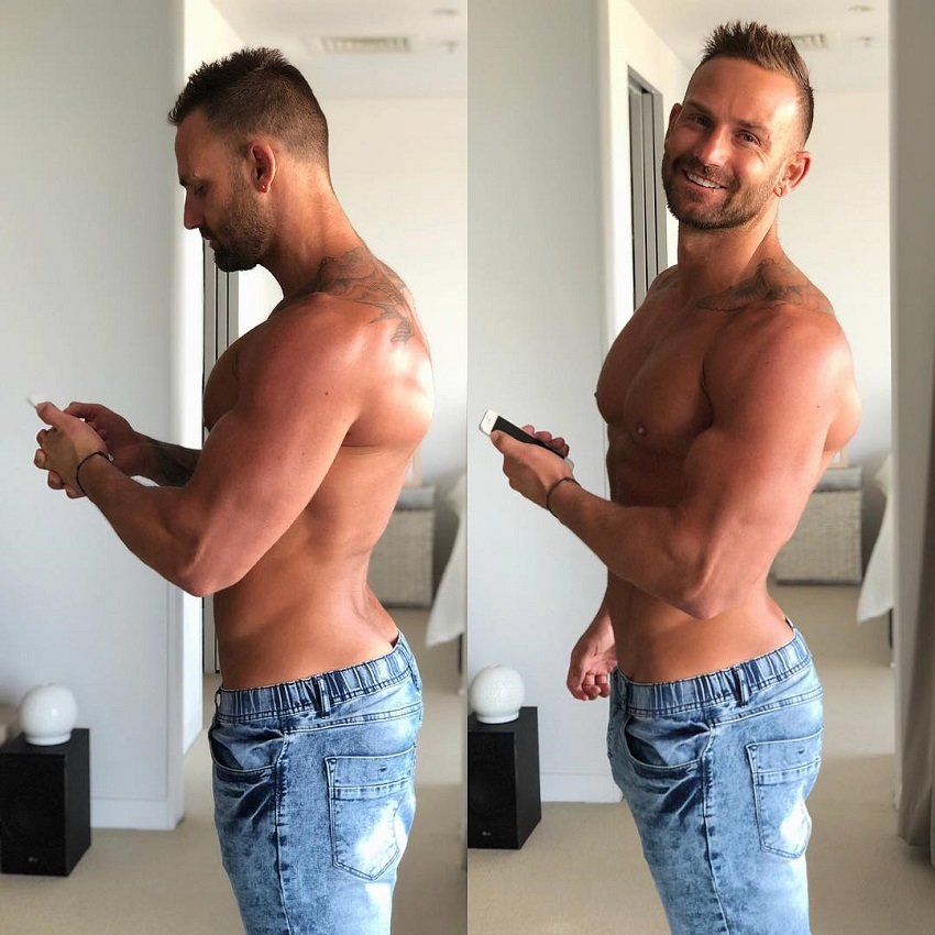 Joel Bushby posing for a photo showing his body from the side