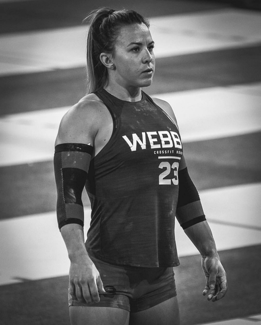 Kara Webb Saunders standing on a track during a CrossFit contest, looking strong and healthy
