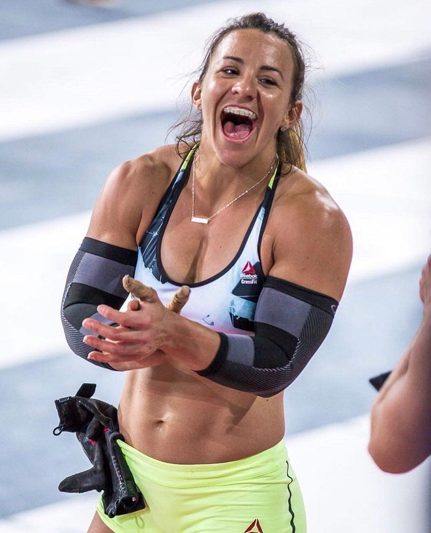 Kara Webb Saunders clapping and smiling during a CrossFit contest