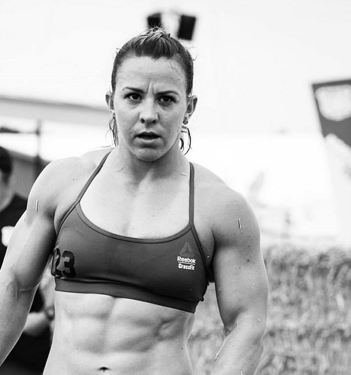 Kara Webb Saunders during a CrossFit competition her abs looking ripped