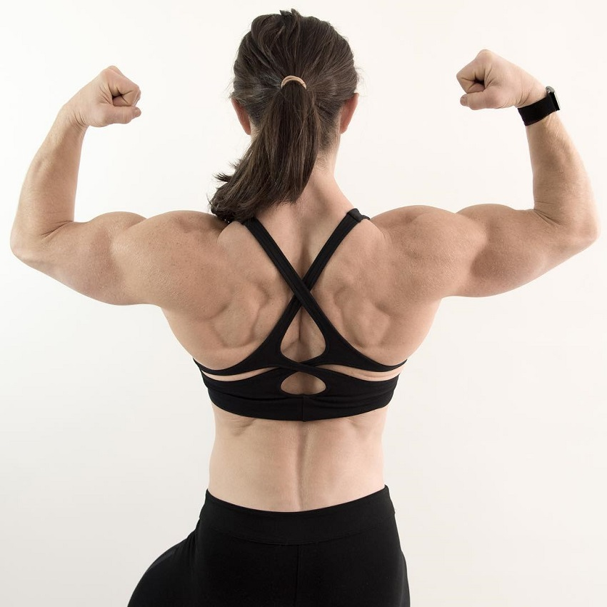 Kari Pearce performing a back double biceps looking strong