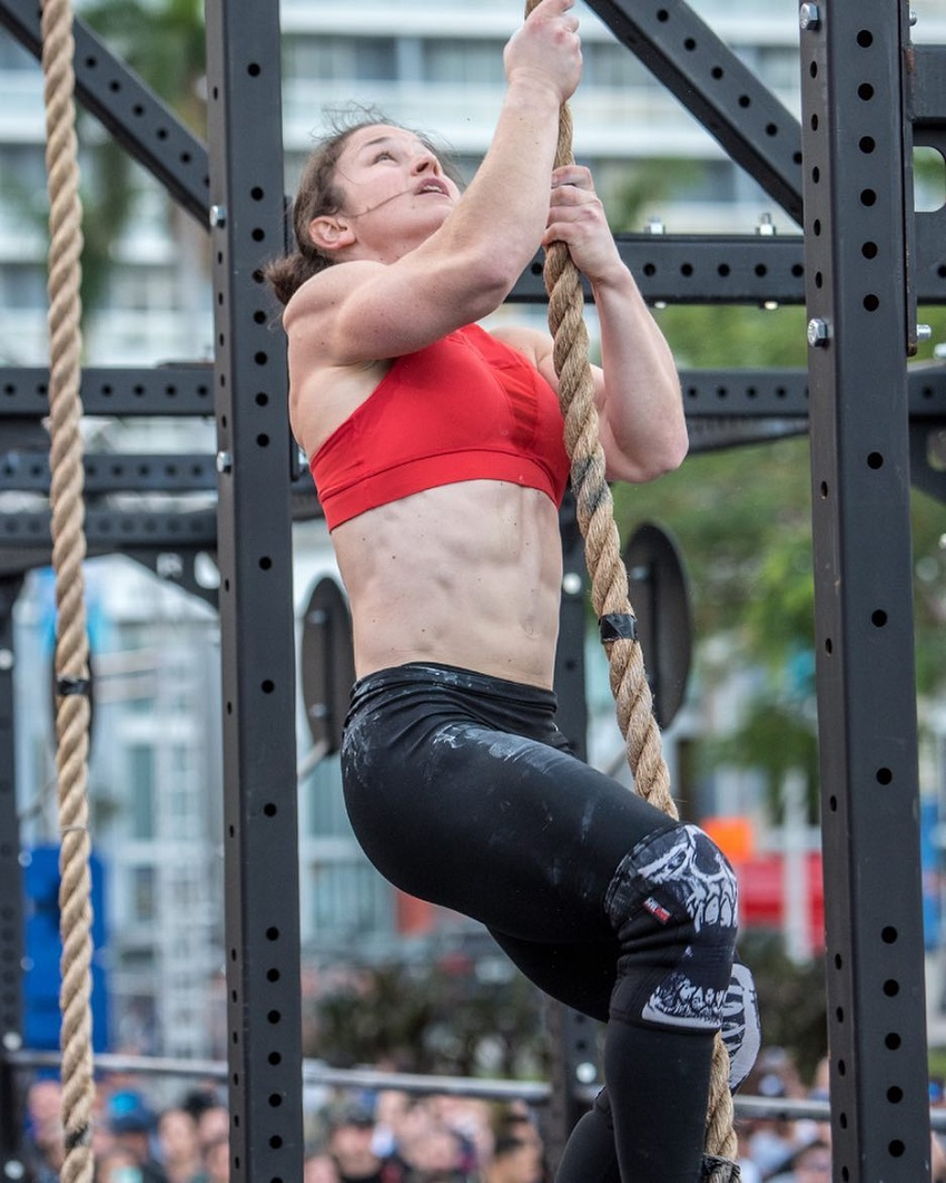 Kari Pearce climbing a rope during a CrossFit contest