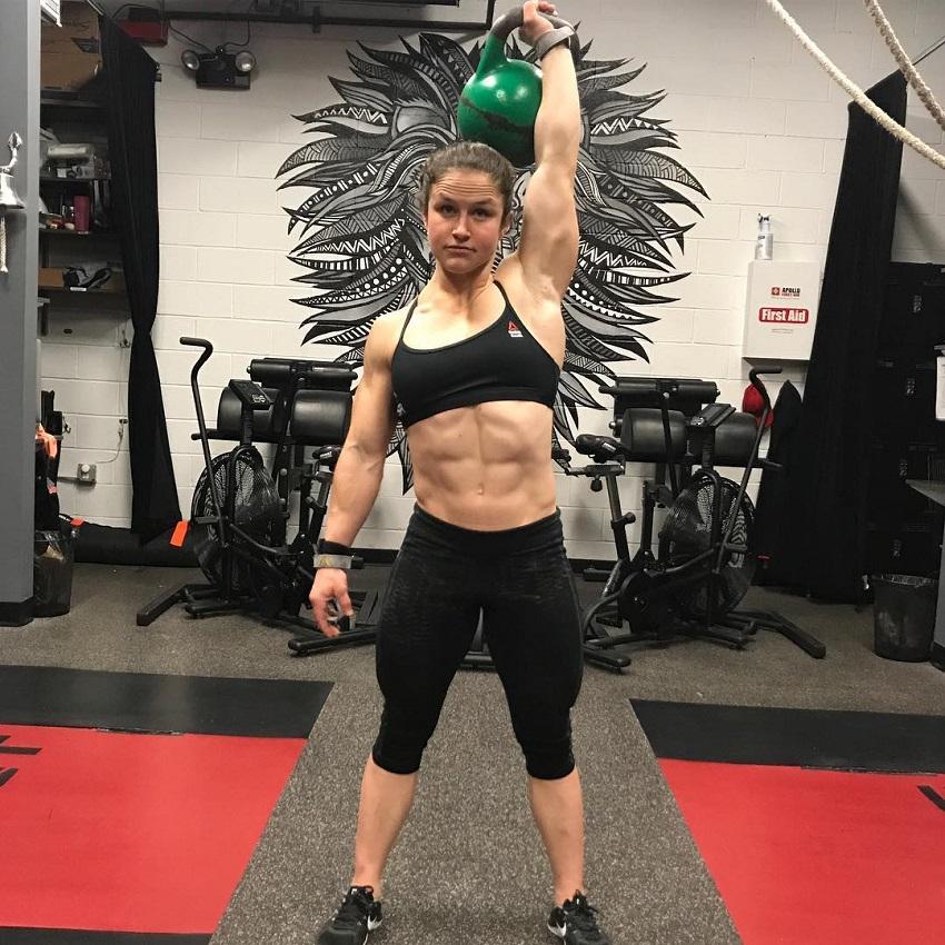 Kari Pearce lifting a kettlebell