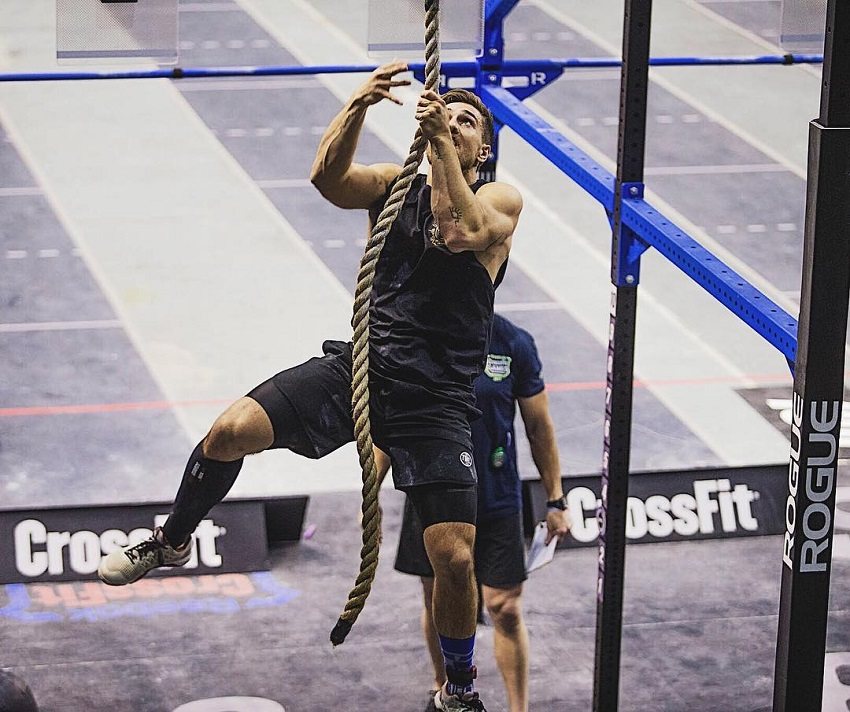 Khan Porter climbing rope in a CrossFit event