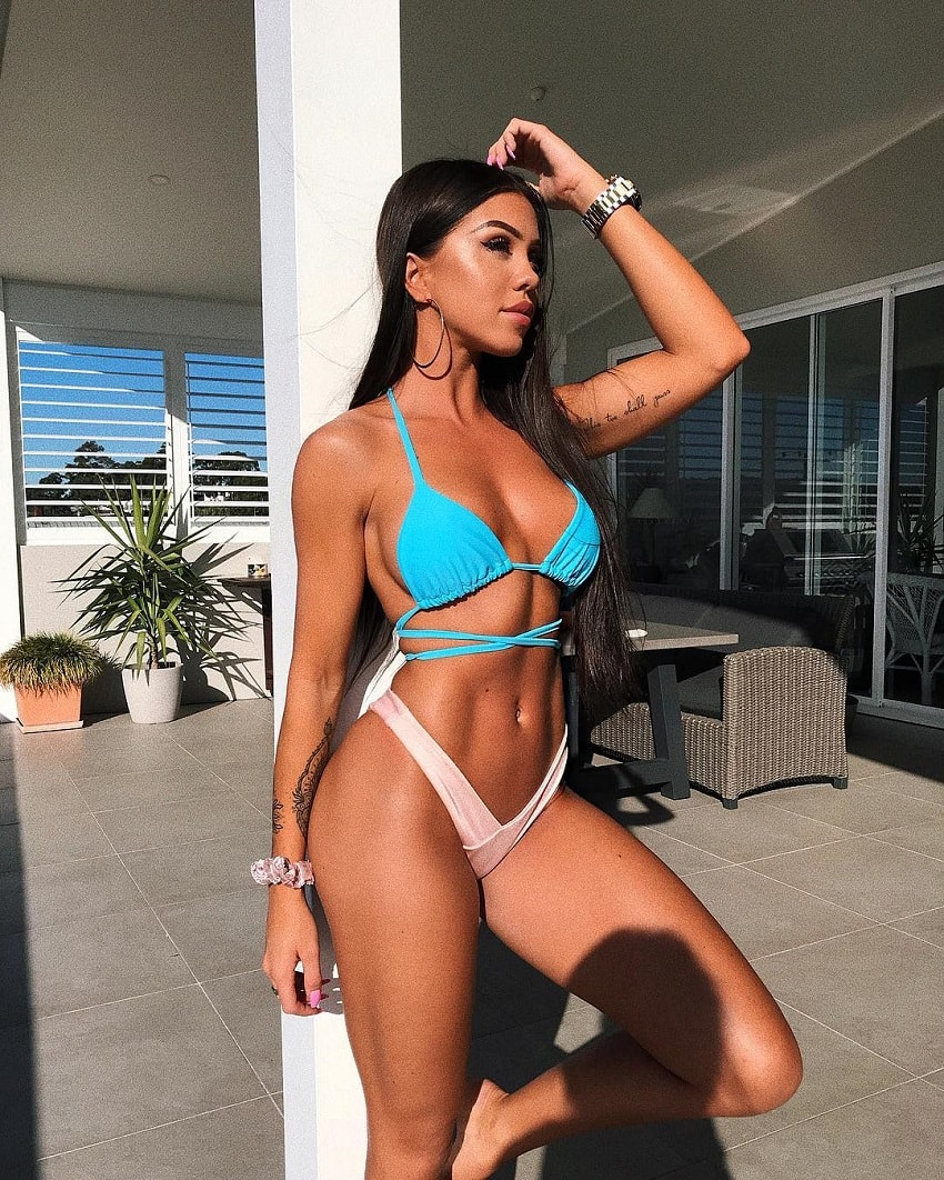Laura Amy showing off her lean and fit figure in a blue bikini