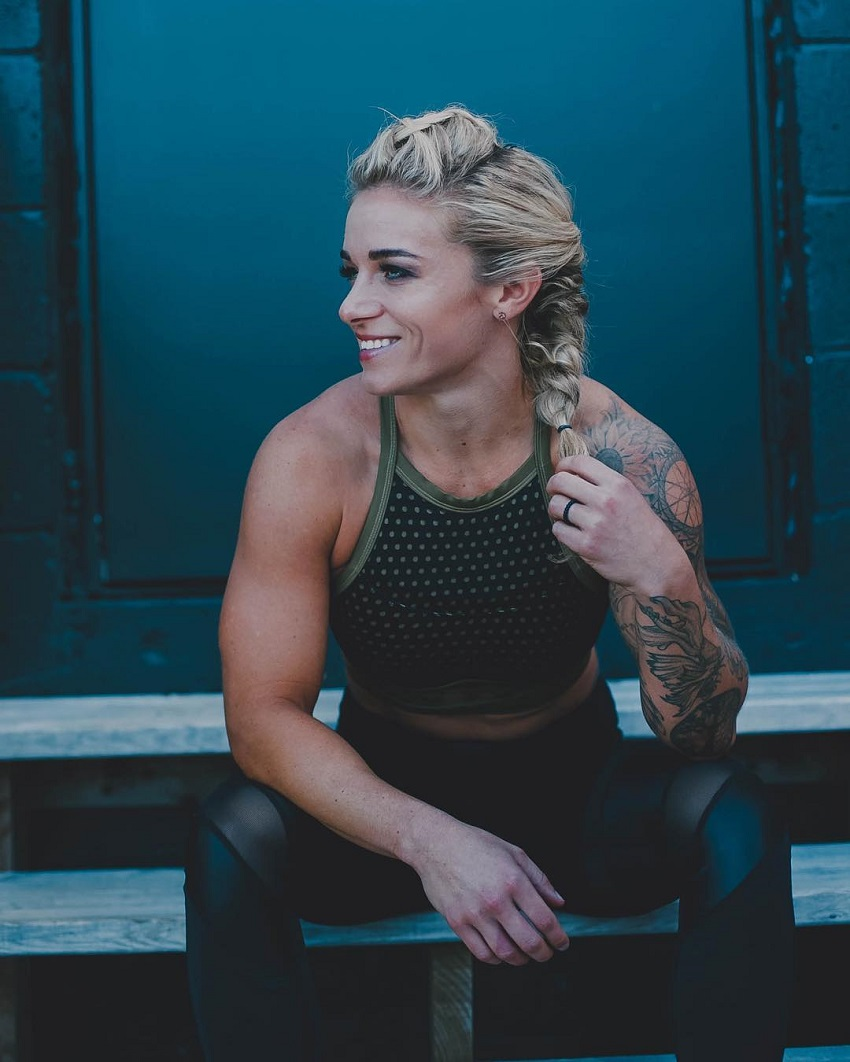 Lauren Herrera sitting and smiling looking muscular and fit