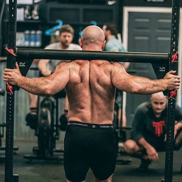 Lucas Parker carrying heavy weights on his back during CrossFit training