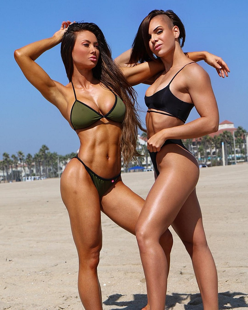 Michell Kaylee posing with Michie Peachie in bikinis on the beach