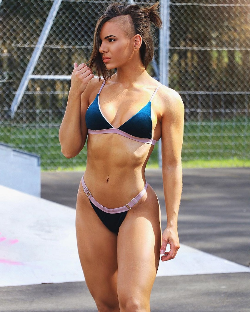 Michell Kaylee standing outdoors in a bikini looking lean and fit