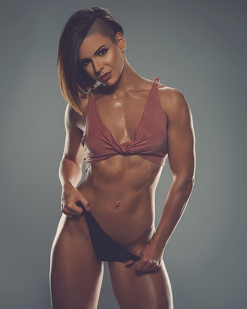 Michell Kaylee posing in a modeling photo shoot looking fit and lean