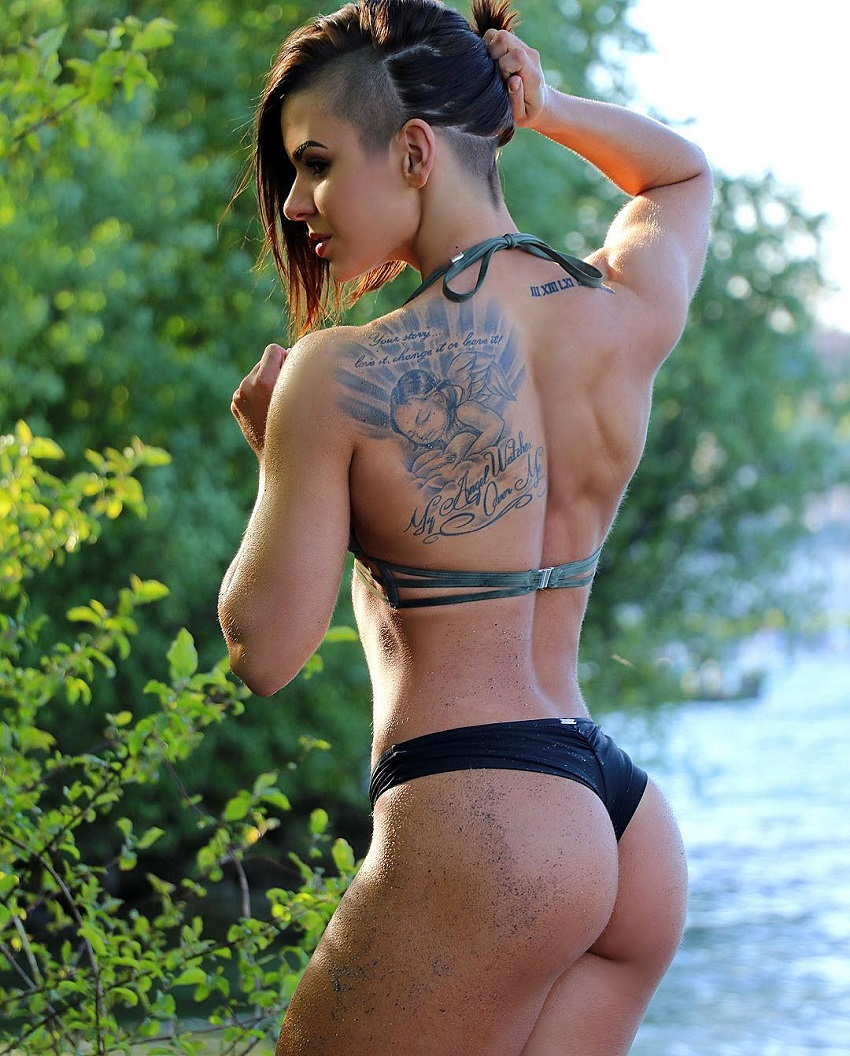Michell Kaylee posing by the river in her bikini, looking curvy and fit