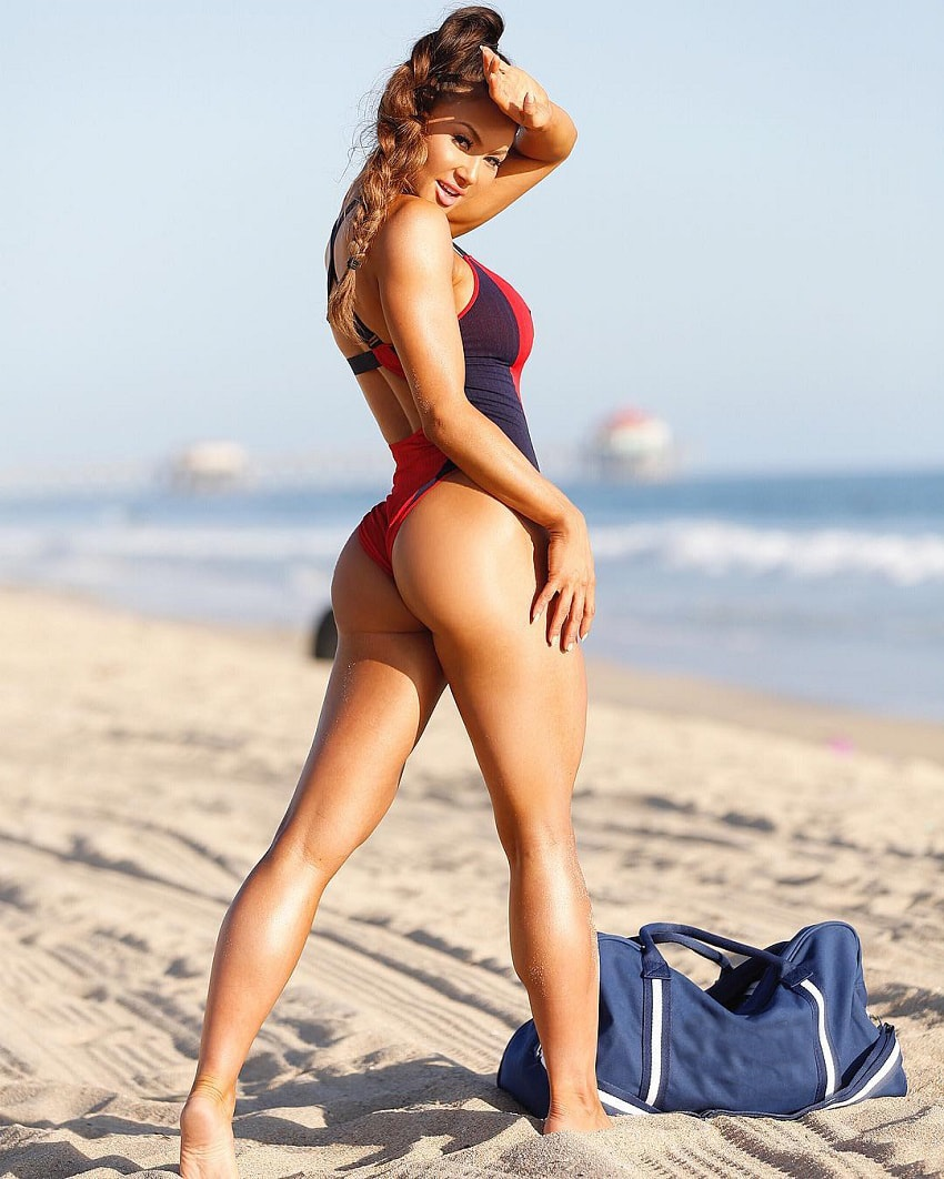Michie Peachie posing on the beach looking curvy and fit