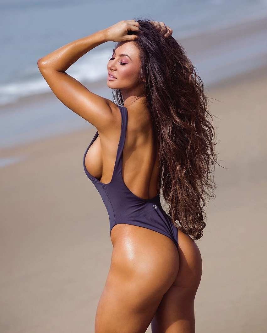 Michie Peachie standing by a beach looking curvy and toned