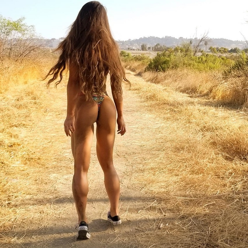 Michie Peachie standing on a grass path in her bikini and vanns shoes, showing off her curvy and lean body
