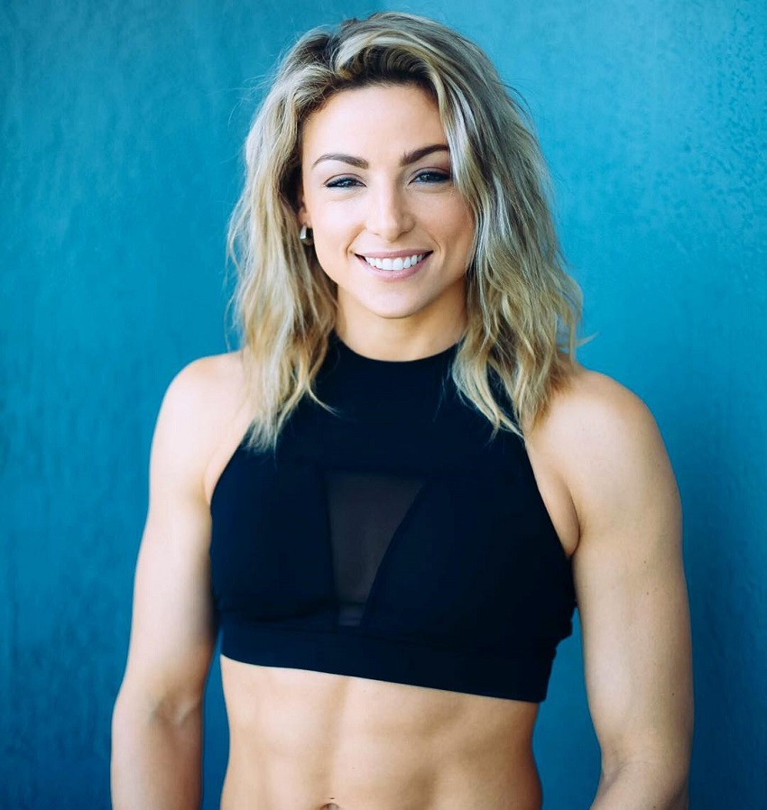 Tiffany Szemplinski posing for a picture smiling and looking fit
