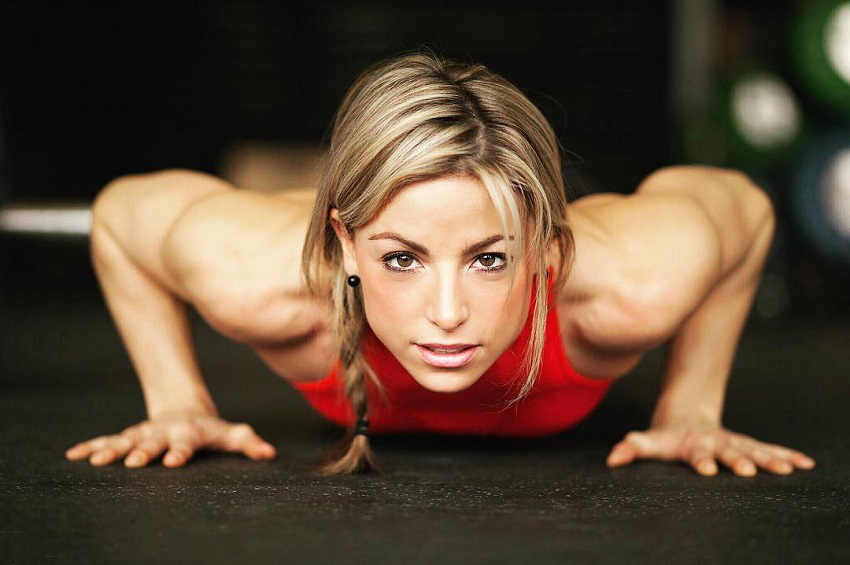 Tiffany Szemplinski doing push-ups looking straight at the camera