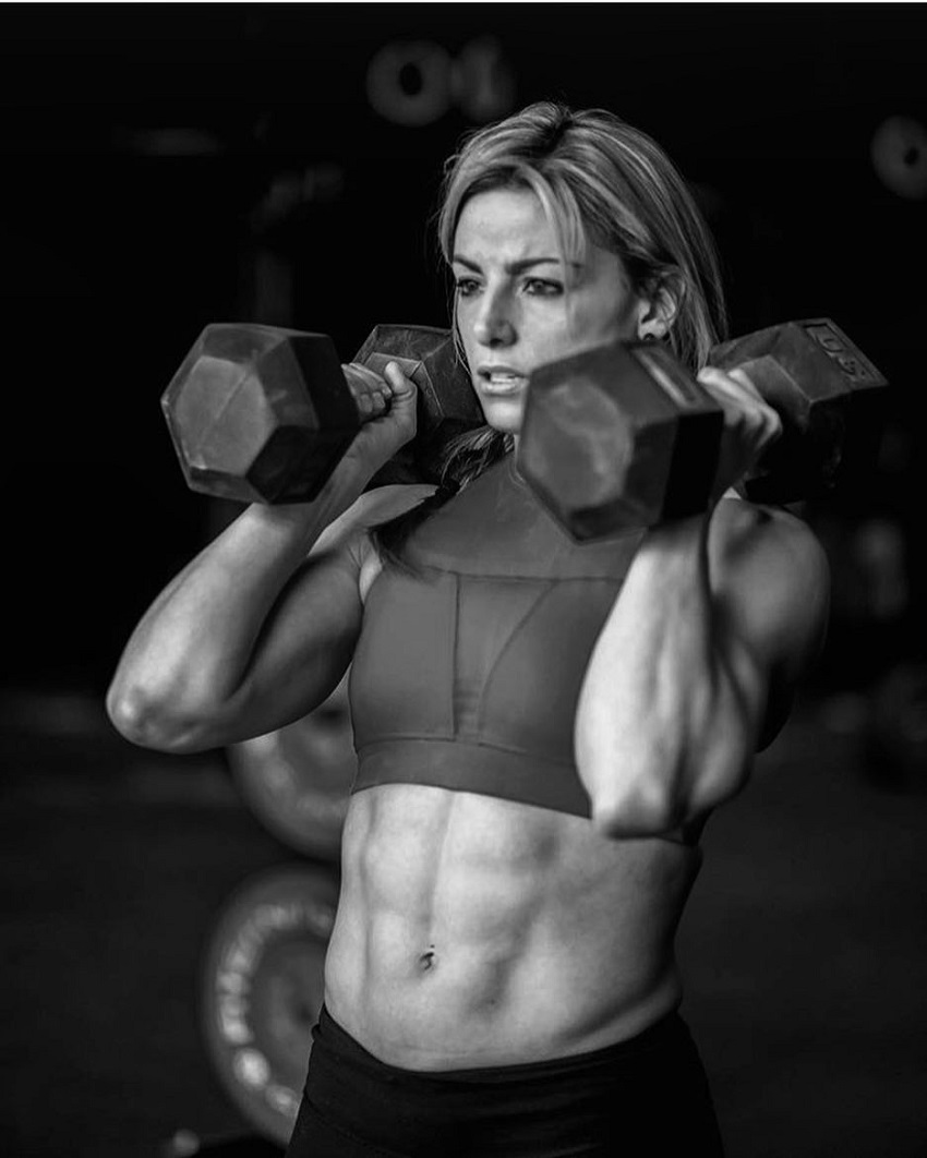 Tiffany Szemplinski training with two dummbells, looking lean and fit