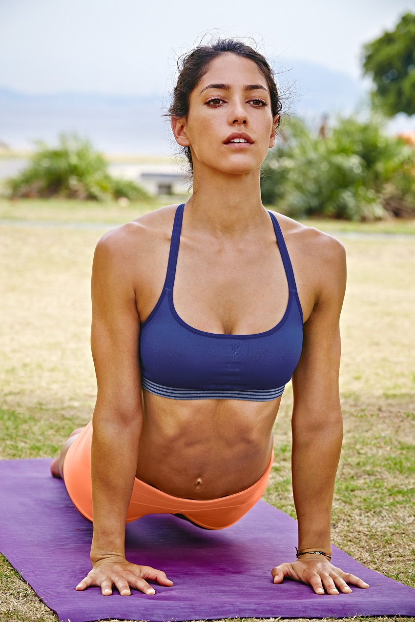 Allison Stokke stretching outdoors looking fit and lean