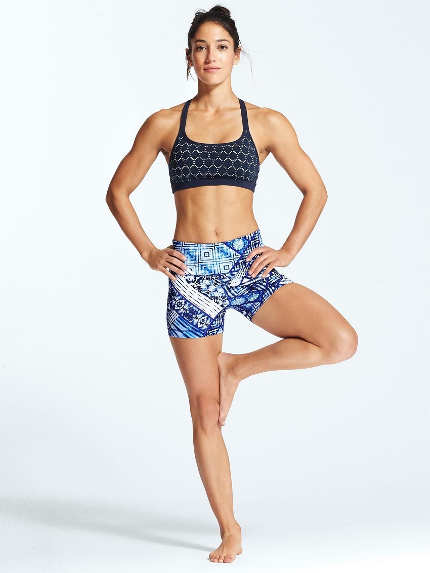 Allison Stokke posing in a photo shoot looking fit and lean