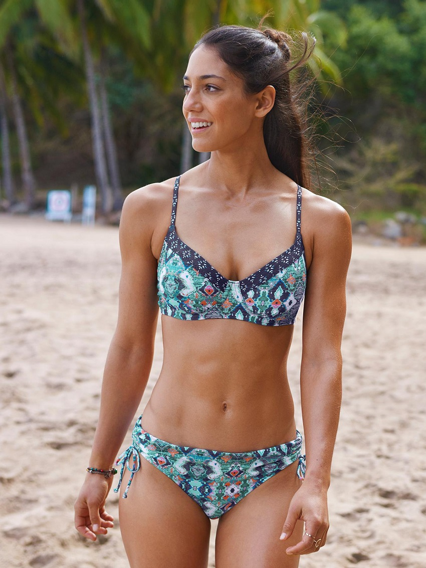 Allison Stokke posing in a bikini on the beach looking healthy