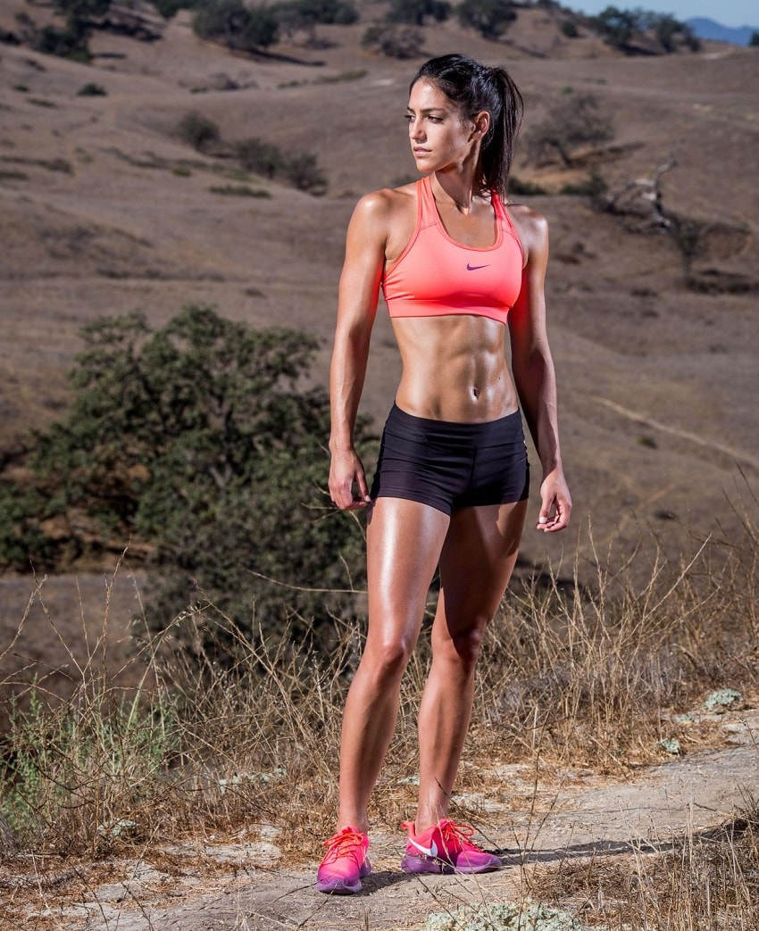 Allison Stokke standing outdoors in the desert looking fit and lean