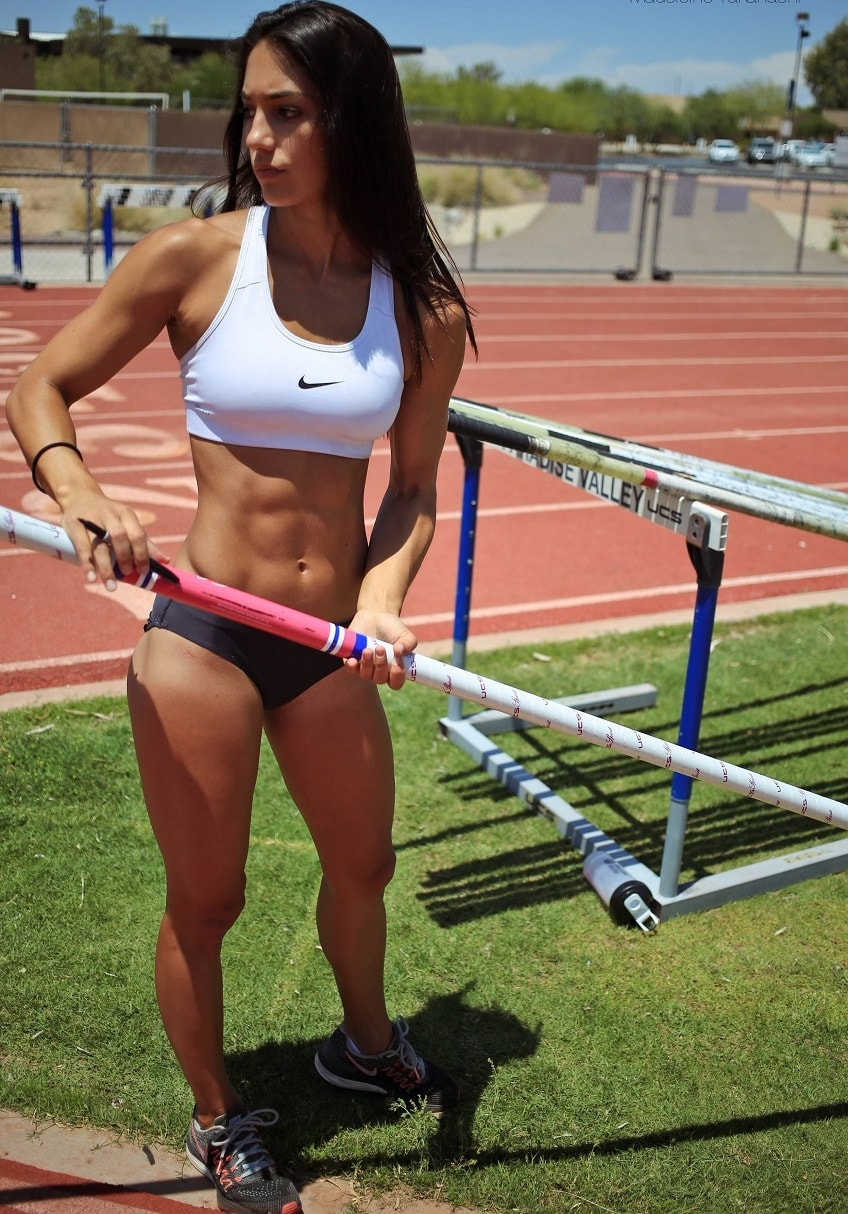 Allison Stokke practicing ple vault on a track looking lean and toned