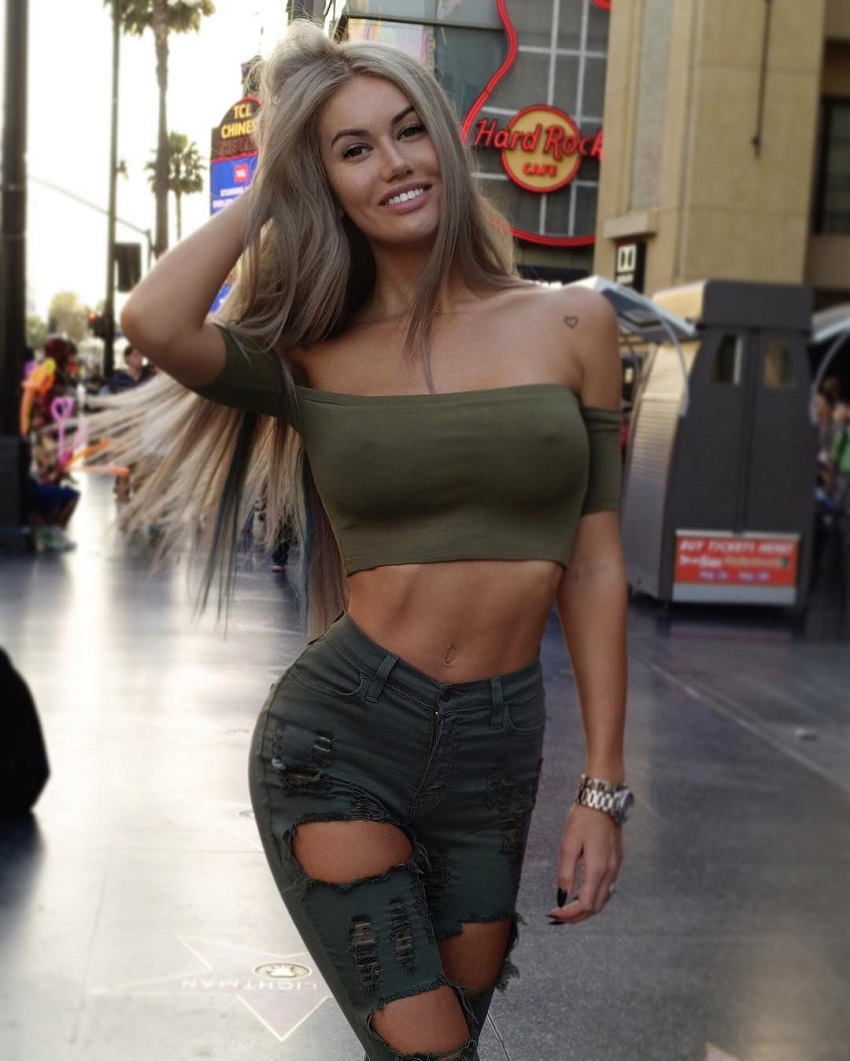 Anella Miller walking down the Hollywood Boulevard looking busty and lean