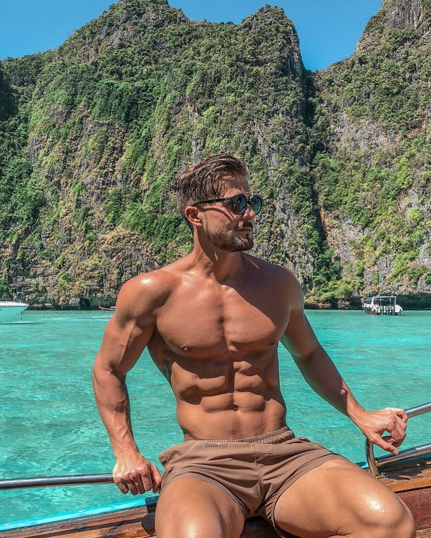 Antonio Pozo posing for a photo while sitting on a boat in an exotic blue sea