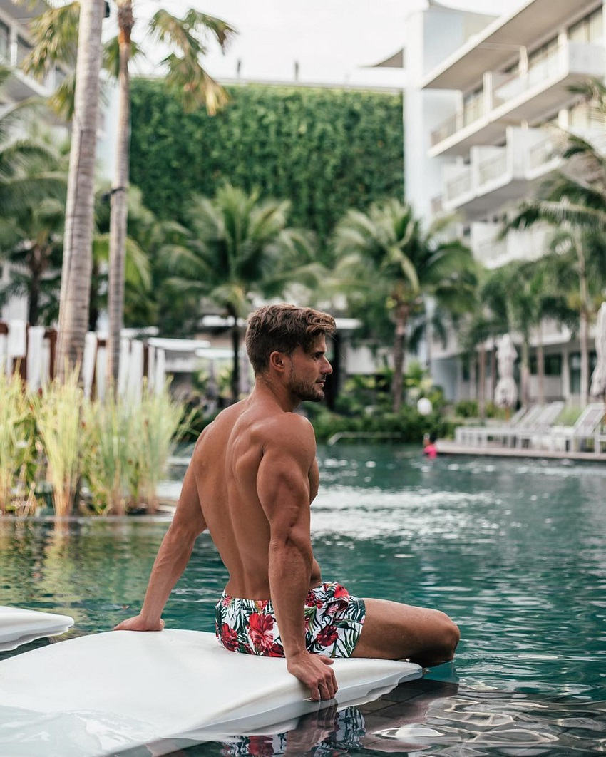 Antonio Pozo sitting by the pool looking fit and lean