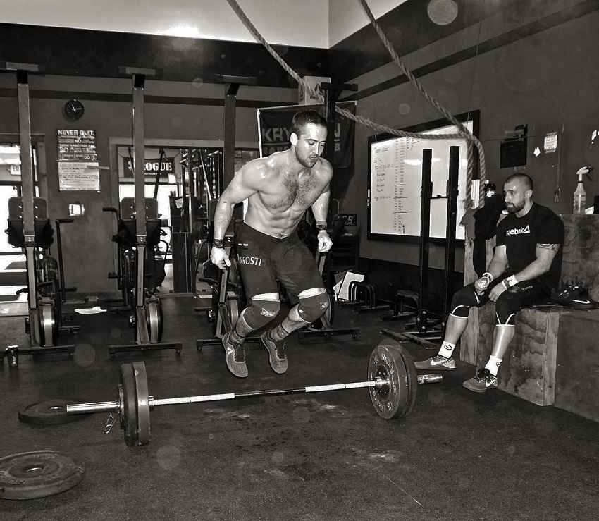 Ben Smith jumping over a barbell