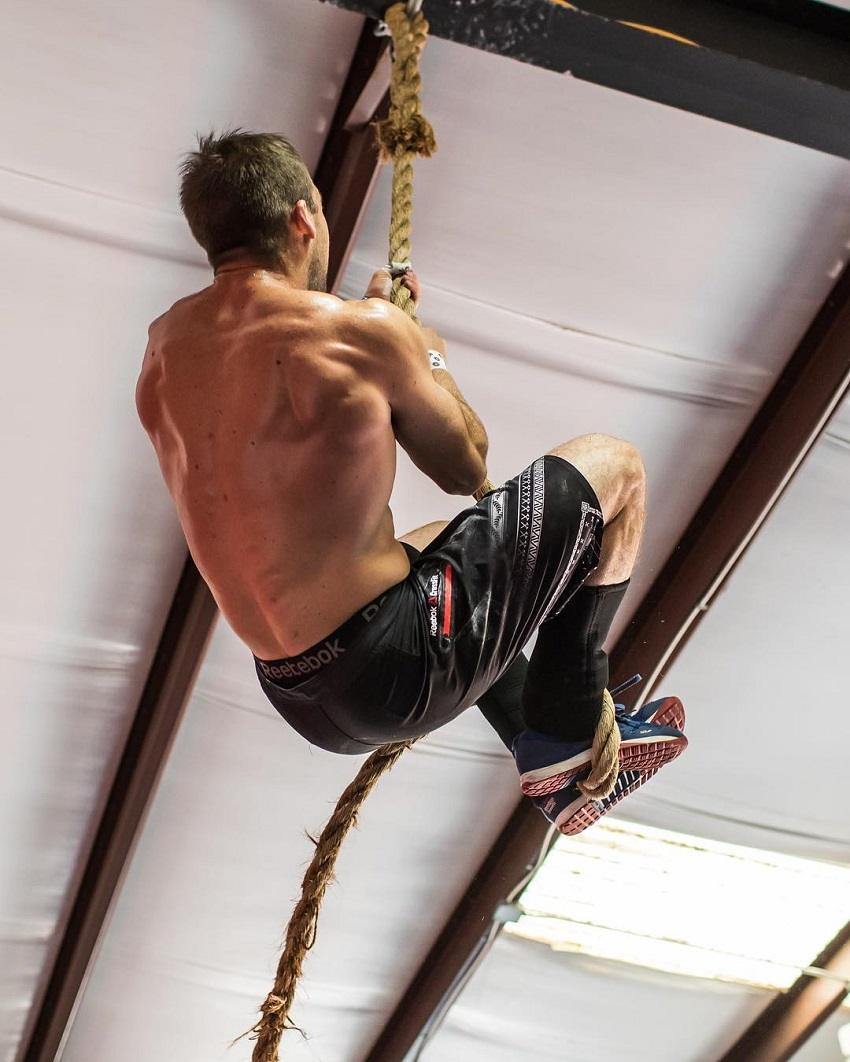 Ben Smith climbing rope shirtless