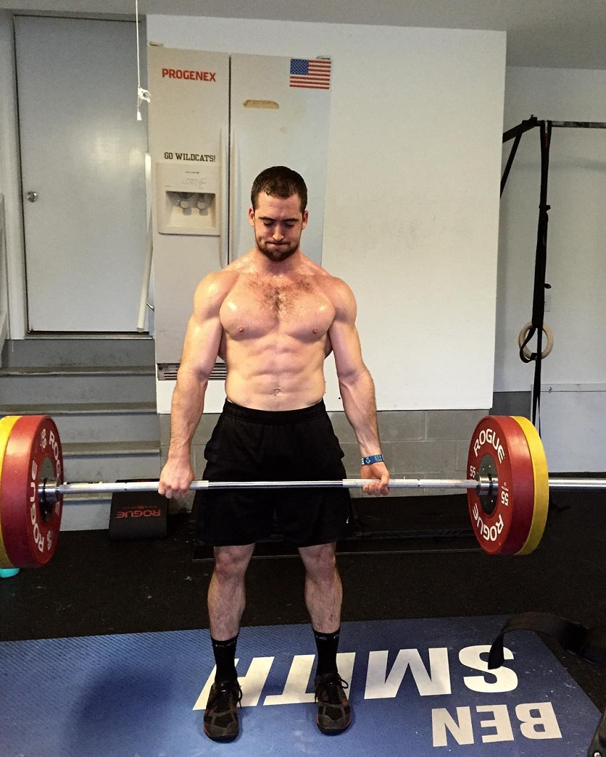 Ben Smith lifting a heavy barbell while being shirtless