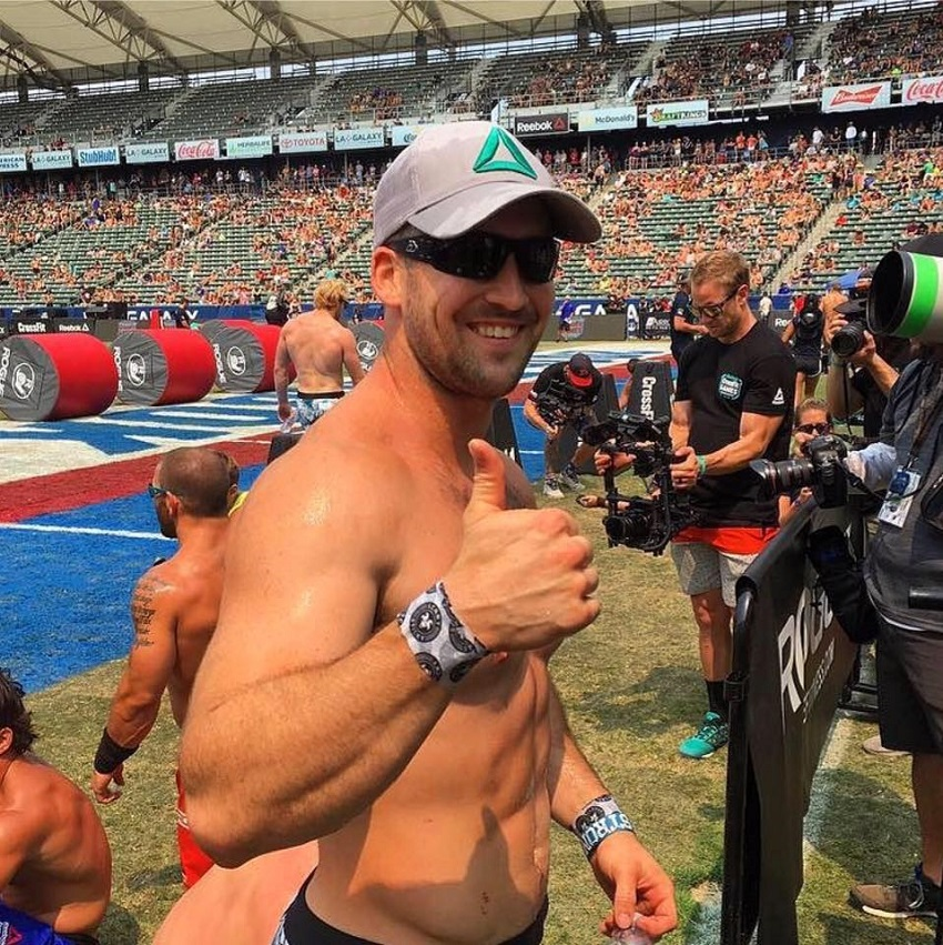 Ben Smith showing thumbs up for the picture during a CrossFit event