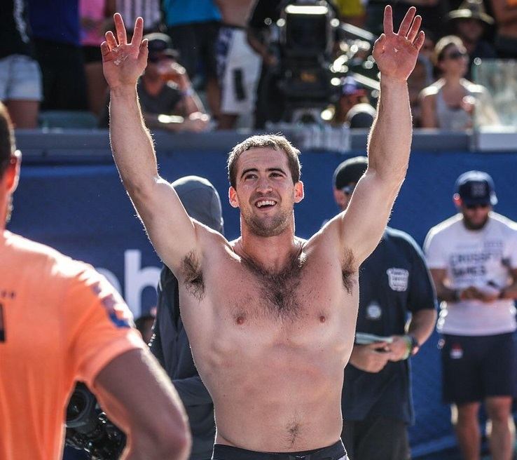 Ben Smith waving at the crowd during a CrossFit competition