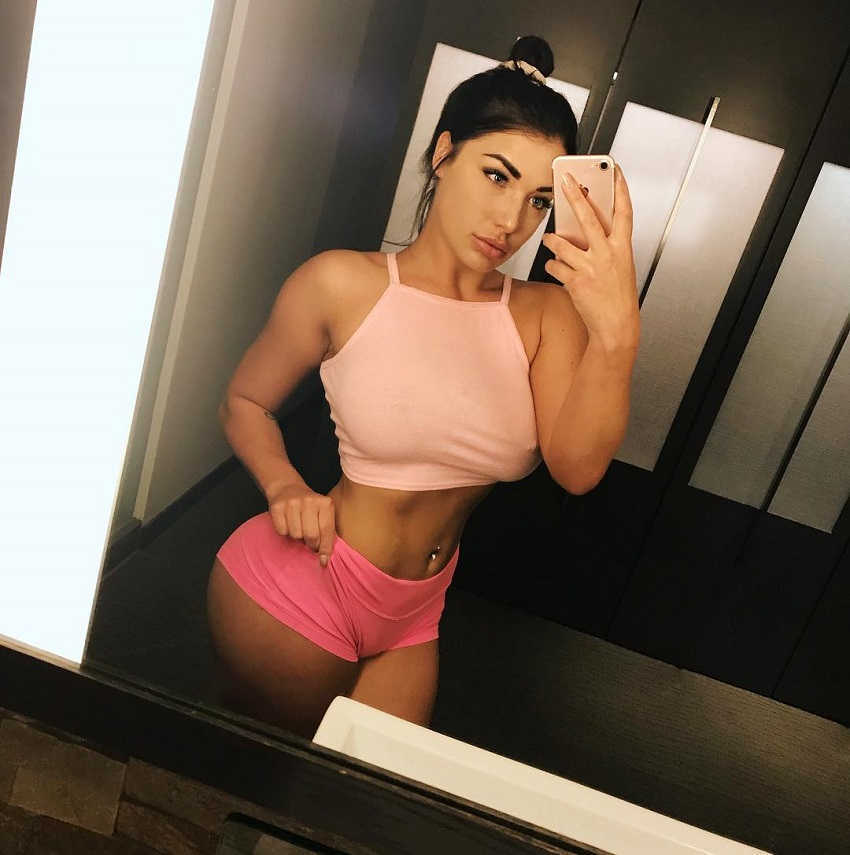 Breanna Soligny taking a selfie of her curvy physique in the mirror