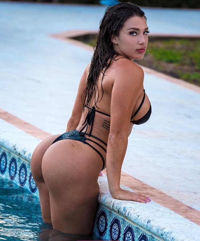 Breanna Soligny coming out of a pool looking curvy and lean