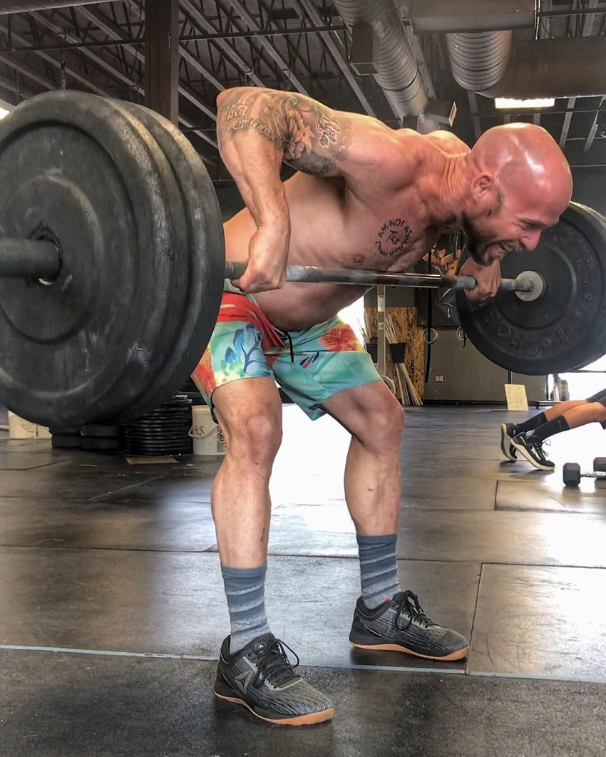 Chris Spealler doing heavy barbell rows looking fit and strong