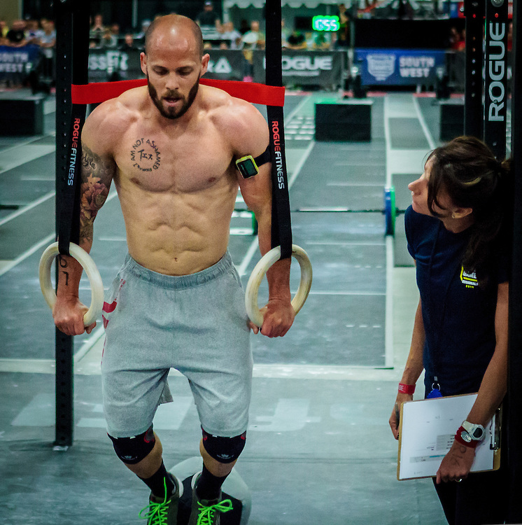 Chris Spealler doing ring exercises during a CrossFit competition
