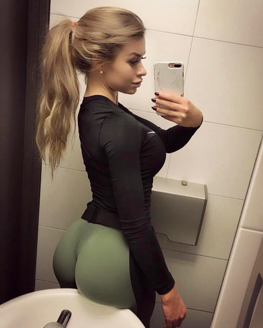 Clara Lindblom taking a selfie of her curvy glutes in the bathroom