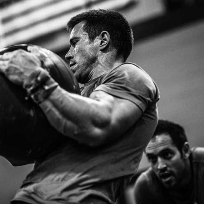 Dan Bailey lifting a heavy bag during crossfit workouts