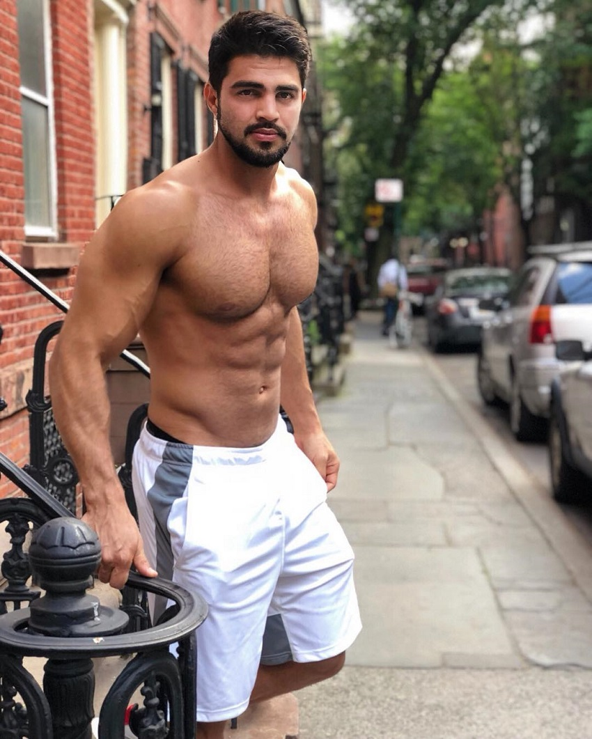 Jefferson Ferreira standing shirtless on the street looking ripped and muscular