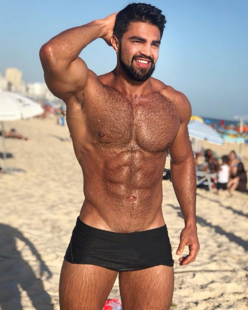 Jefferson Ferreira posing shirtless on the beach looking ripped and lean