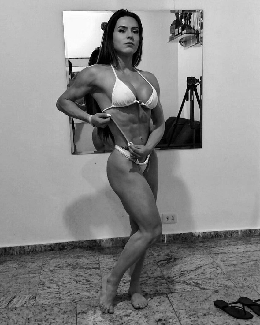 Karen Ranocchia Brandao posing for a photo in a white bikini looking aesthetic