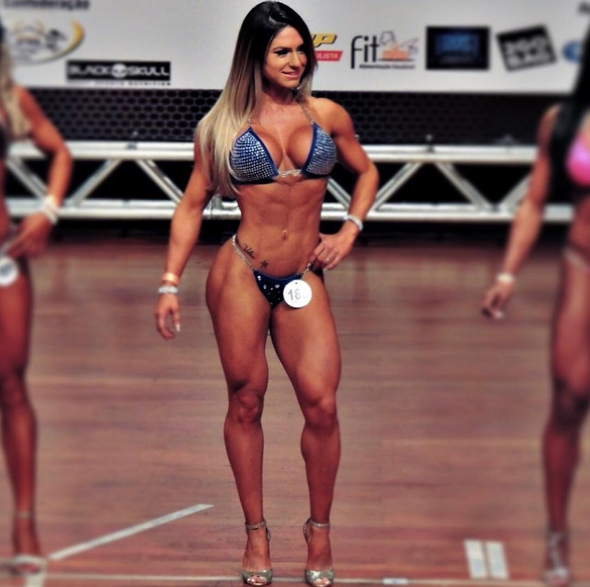 Karen Ranocchia Brandao posing in the fitness and wellness stage looking fit and lean.